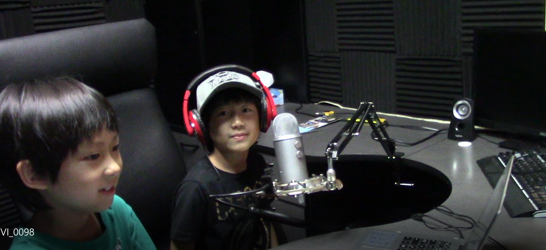 2 boys in voice studio.