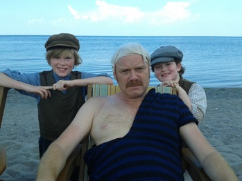 William Healy and Nicholas Healy are on the set of the TV program Murdoch Mysteries along side Thomas Craig an English actor known for his roles in Murdoch Mysteries, Coronation Street, and The Navigators.